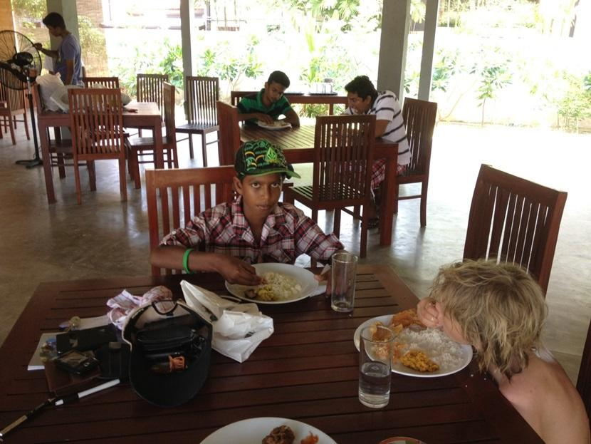 Rupert eating with his hands