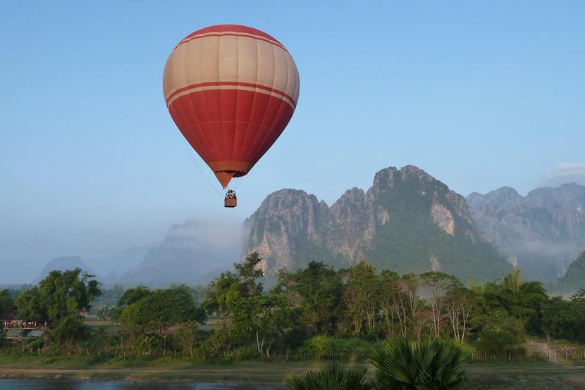 Hot air balloon floating over Vang Vieng