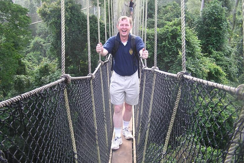 A man walking a canopy platform