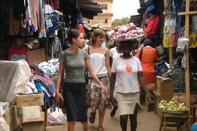 Girls wander through market place