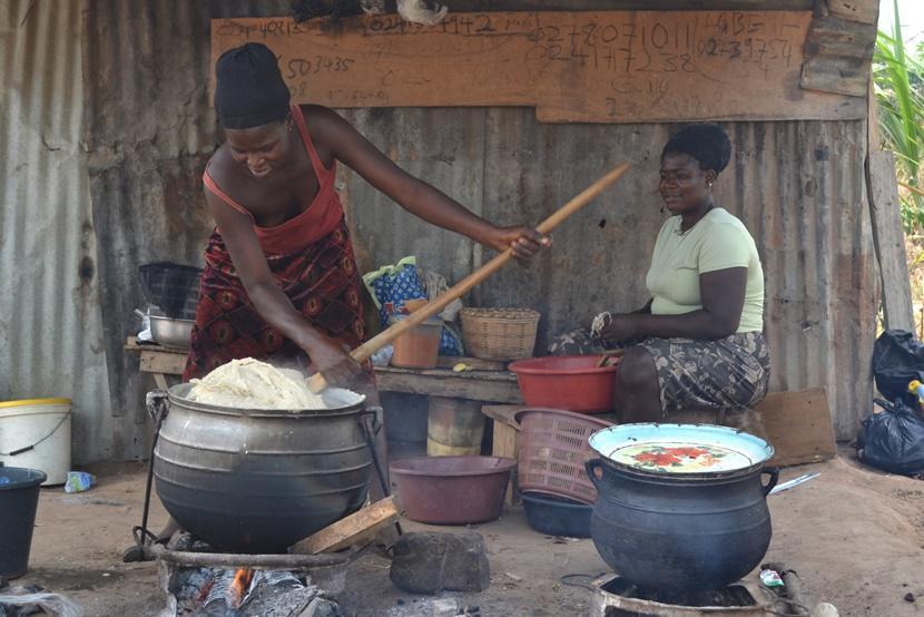 Two women prepare food