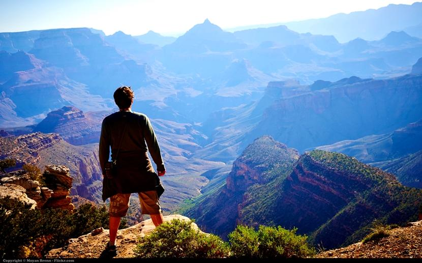 A man looking at the view of the Grand Canyon
