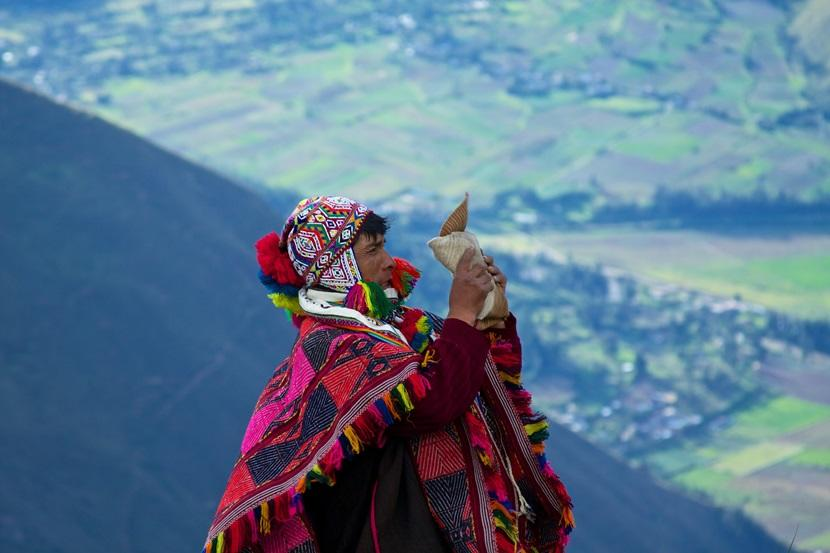 Peruvian man wearing chullo and poncho