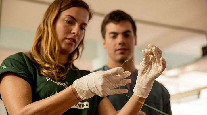 A Projects Abroad medicine volunteer from Denmark, learns how to tie a suture during a medicine workshop at the Museo de Anatomia in Cordoba, Argentina