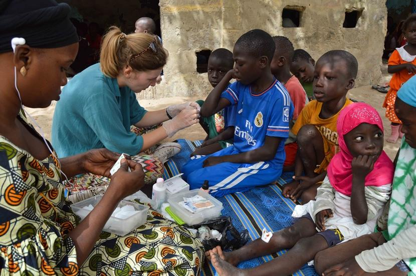 A Belgian Projects Abroad volunteer and local staff provide medical care to children at a daara in Saint Louis, Senegal