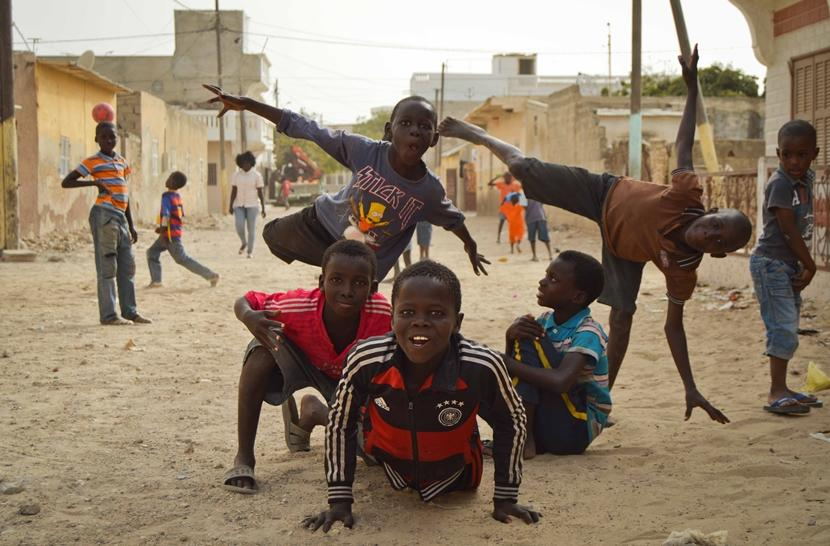 Talibe boys play in the street outside the Projects Abroad Care centre in Saint Louis, Senegal