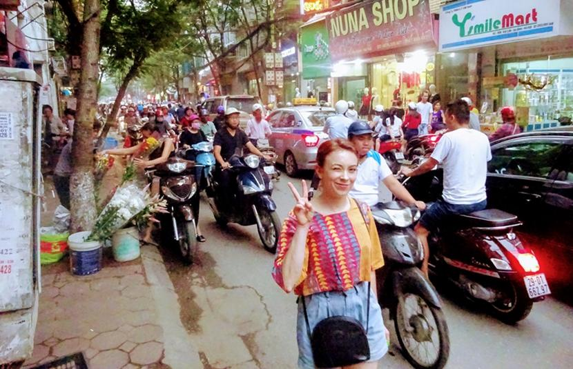 Australian Projects Abroad volunteer on a busy road in Vietnam
