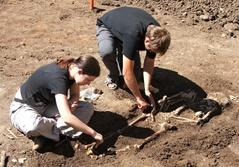 A group of Projects Abroad volunteers excavate a digging site at the Archaeology Project in Romania.