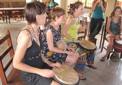Volunteers participating in a traditional drumming music lesson on their Culture & Community Project in St Louis, Senegal.