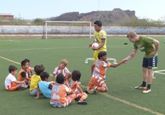 Volunteer and local staff coaching soccer to young children at a school in Ecuador, South America