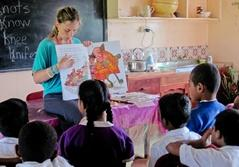 A Fiji teaching volunteer reading a story to students at her project in a school