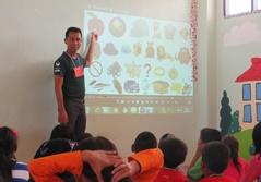 Teaching volunteer presenting the daily lesson in a classroom to children in Thailand, Southeast Asia