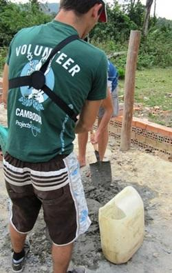 Volunteer building the playground