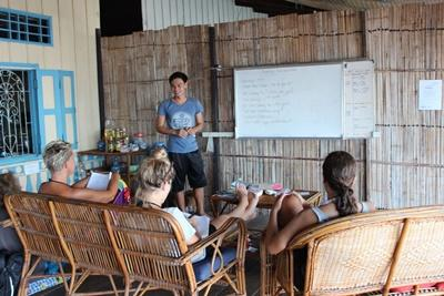Projects Abroad Marine Conservation volunteers take part in a Khmer language class in Cambodia
