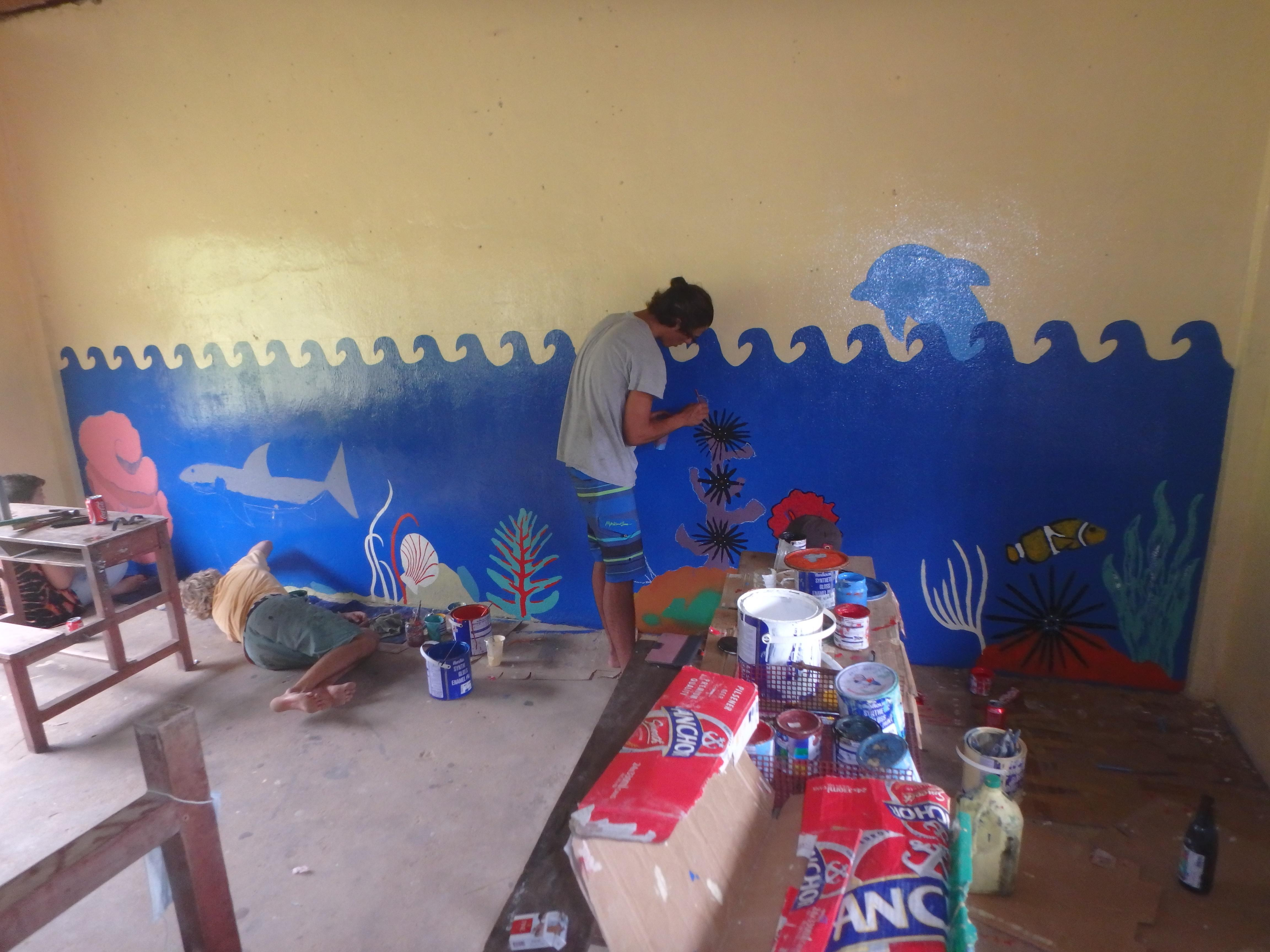 Volunteers painting at the local school