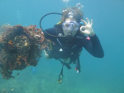 Projects Abroad volunteer explores the underwater world of the Koh Sdach Archipelago during a dive at the Marine Conservation project in Cambodia