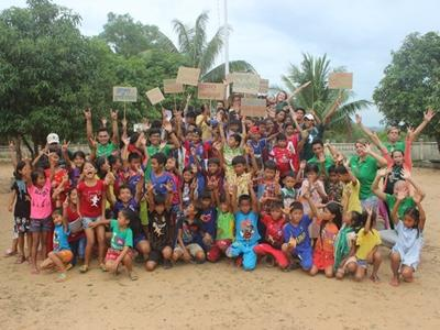 Volunteers and staff with children on World Oceans Day
