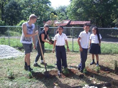 Projects Abroad volunteers working with local school children on a biogarden project in Costa Rica