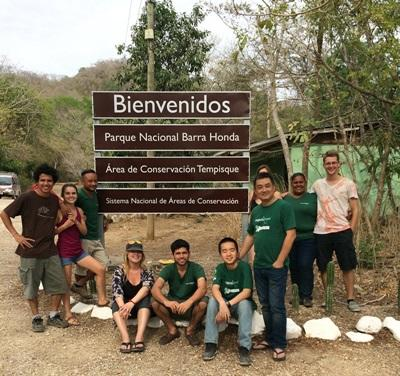 Projects Abroad Costa Rica staff and volunteers pose at the entrance to Barra Honda National Park, where they are taking part in several conservation projects.