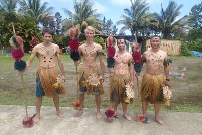 Male volunteers in traditional dress
