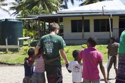 A volunteer with some of the village children in Fiji