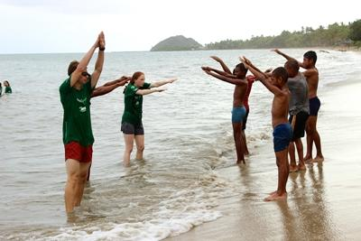 Projects Abroad volunteer teaches local children how to swim at Fiji Marine Conservation project