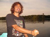 Roberto paddling boat on the lagoon