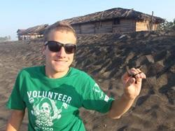 Conservation volunteer with hatchling