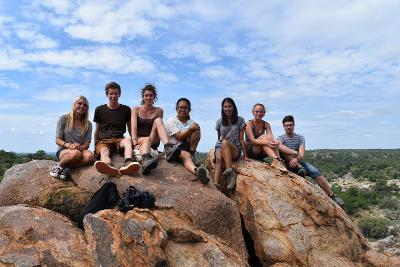 A group of volunteers enjoy the view from the top of a koppie