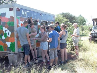 Conservation volunteers painting to create an anti-poaching unit