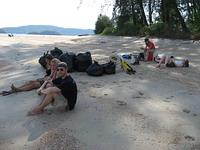 Exhausted volunteers after a beach clean