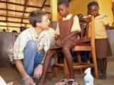 Treating wounds at Kwamoso School