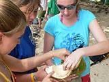 Eating the coconut flesh