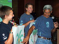 Volunteers and staff explaining mangroves