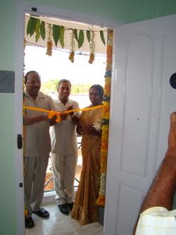 Dr GK cutting the ribbon