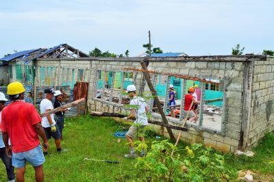 Volunteers rebuild a school on Cebu Island, Philippines