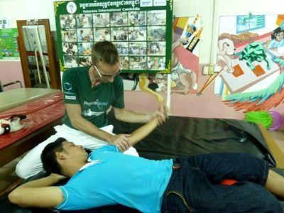A local Cambodian is provided with physiotherapy