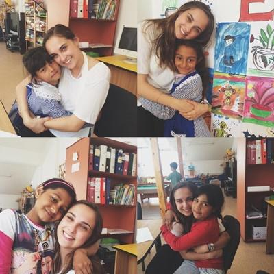 A Drama volunteer gives hugs to Romanian children at her project.