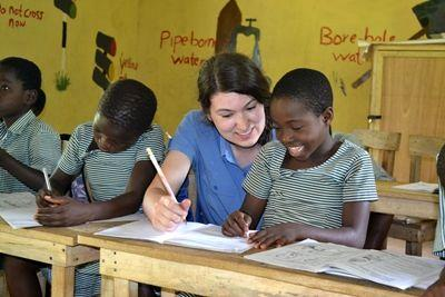 A Projects Abroad Teaching volunteer from Canada assists a Ghanaian student in a class at the Wonderful Love School in Akuapem Hills.