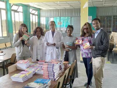 Projects Abroad staff and volunteers present a donation of academic and fictional books to the Director of Berhane Zare School in Addis Ababa, Ethiopia