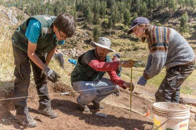 Volunteers on the Archaeology Project log the dimensions of the excavation site in Sacsayhuaman