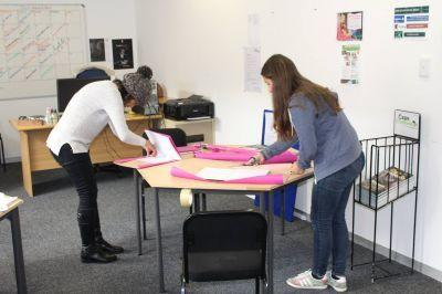 Projects Abroad Journalism interns cover books for a writing workshop at Vredelus House in Cape Town, South Africa