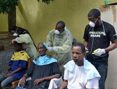 Projects Abroad Jamaica volunteers and staff provide grooming services to homeless men in Kingston during World Homeless Day on October 10th, 2015