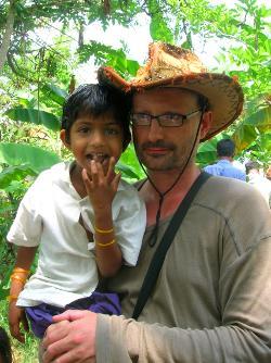 Older volunteer with kid in India