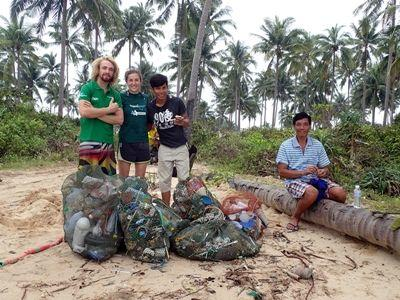 Projects Abroad Marine Conservation volunteer, Kate Jackson from Australia, takes part in a beach clean-up at her placement in Cambodia.