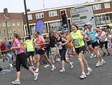 Emily running the Marathon