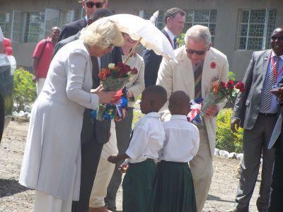Prince Charles and Camilla meeting local children