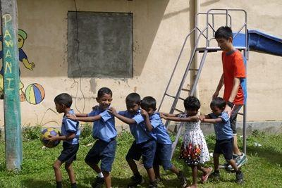 Projects Abroad Care volunteer, Herman Chi Hong Chan, plays games with children at his placement at Dutch Anne Preschool in Panadura.