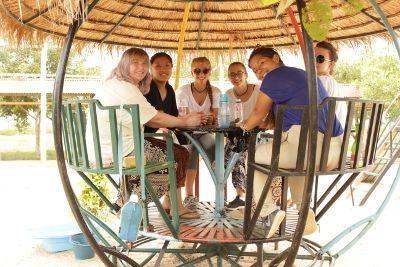 Projects Abroad volunteer, Alice Bowman from Scotland, in discussion with a group of volunteers and local staff members at a Care project in Cambodia