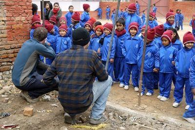 Projects Abroad volunteers meet the kids whose school was rebuilt on the Disaster Relief Building project in Nepal
